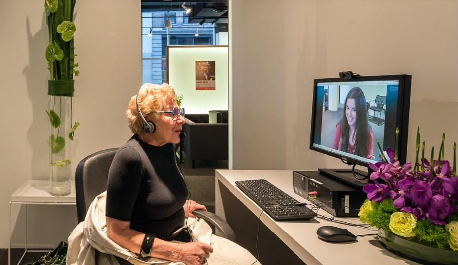 Older adult video conferencing on a computer